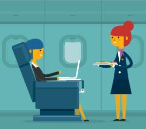 飛行機内でパソコンを使用する人
